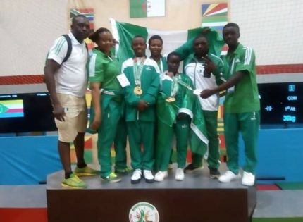 Team Nigeria weightlifter receiving medals