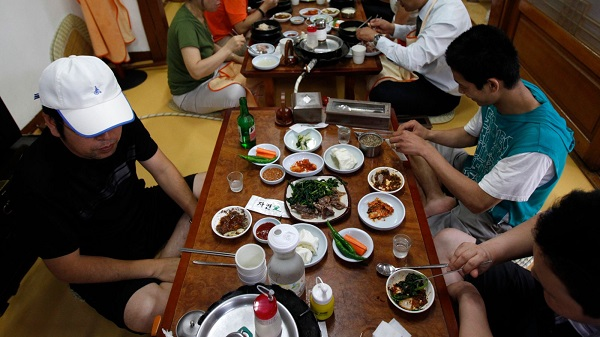 People eat dog meat at a restaurant in South Korea. Sky News